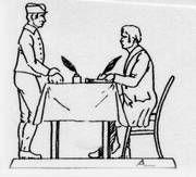 Mann und Schreiber am Tisch